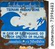 old plate of tsunami hazard zone sign at Phuket province Thailand - stock photo