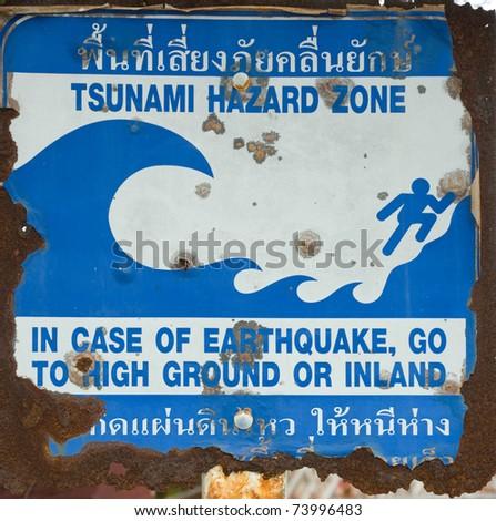 old plate of tsunami hazard zone sign at Phuket province Thailand - stock photo