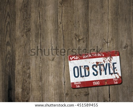 Old plate on wooden background - stock photo
