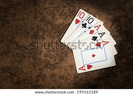 old playing cards collected from a combination of poker full house