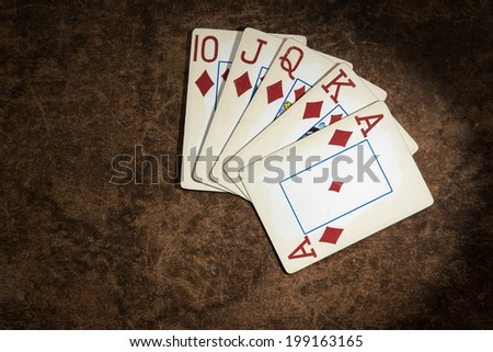 old playing cards collected from a combination of poker royal flush - stock photo