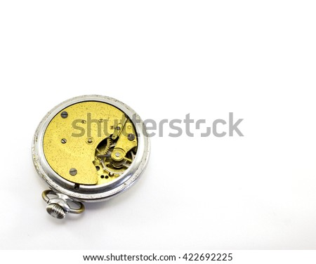 Old pocket watch mechanism on white background - stock photo