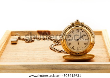 Old Pocket watch on wood