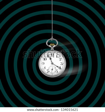 Old pocket watch swinging on spiral background, hypnosis concept - stock photo