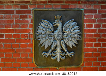 Old polish eagle. National symbol on the stone wall - stock photo