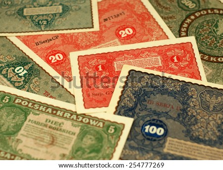 Old Polish notes (1919). Translation of the text on the bill: 'The one who falsifies official notes can be punished'. Focus on some part of the image only - rest is blur by intention. - stock photo