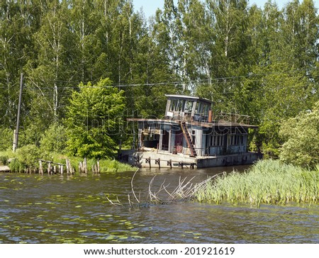 Old pontoon house on river Volga  - stock photo