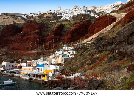 Old port of Amoudi at Oia village of Santorini island in aegean sea, Greece.  Santorini is a volcanic island at the Cyclades. - stock photo