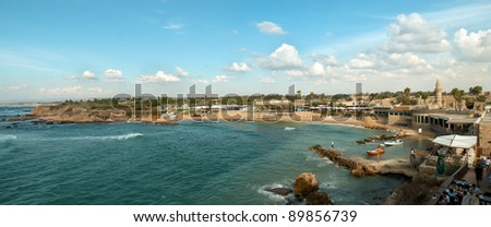 Old port of Caesarea in Israel with crystal clear water Historical landmark . - stock photo