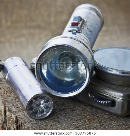 Old portable flashlights - stock photo