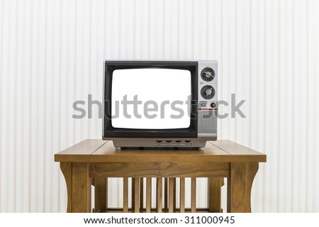 Old portable television with antenna on wood table with cut out screen and clipping path. - stock photo