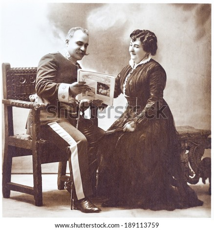Old portrait of marriage. Vintage. Aged copy. 1914s. Studio portrait. The sepia toning.