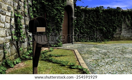 Old post box in front of a traditional house at daylight - stock photo