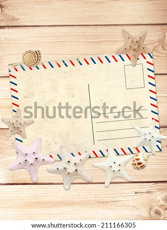 Old postcard and starfishes for scrapbooking