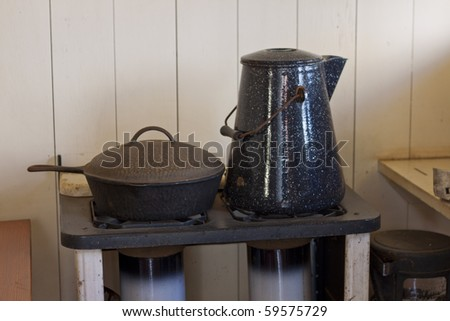 Old pot and kettle - stock photo