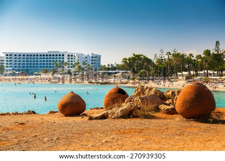 old pots in front of the famous Nissi beach in Aiya Napa, Cyprus - stock photo