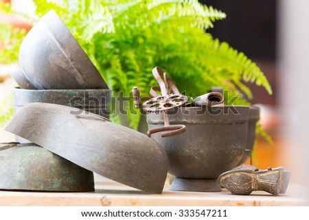 Old pots on the table close up - stock photo