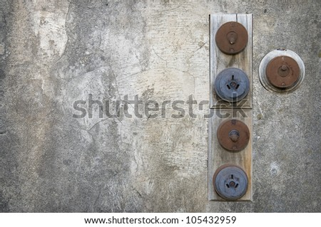 Old power switches on a grungy wall - stock photo
