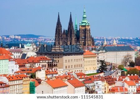 Old Prague panorama with sityscape of Hradcany, St. Vitus Cathedral and red roofs/ czech republic - stock photo