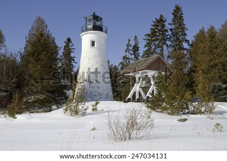 Old Presque Isle Lighthouse during the winter season -- Alpena, Michigan, USA - stock photo