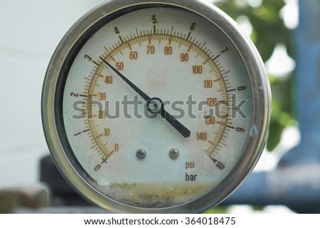 Old pressure gauge, measuring instrument close up - stock photo