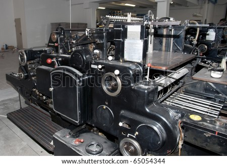 Old print finishing machine in printshop