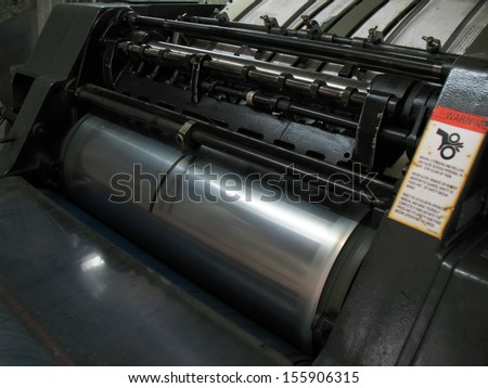 Old printing machine in workshop - stock photo