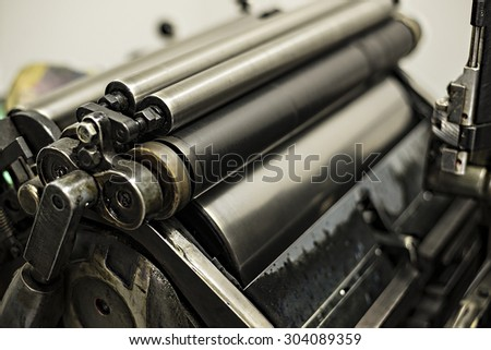 old printing machine with oil, ink and mold - stock photo