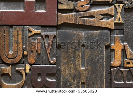 Old printing press letters arranged randomly across. Focus across entire surface. - stock photo