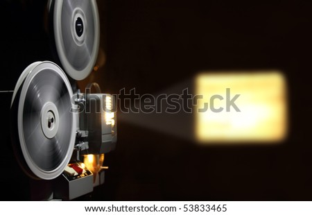 old projector showing the film in dusk - stock photo