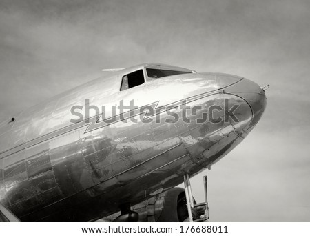 Old propeller airplane in black and white