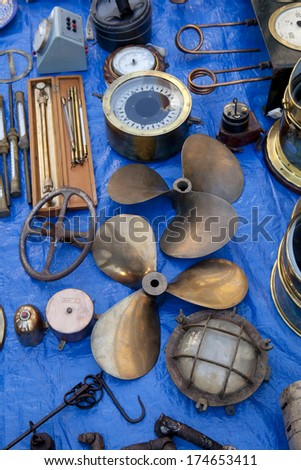 Old Propellers and another naval antiques in a street market. Naval Antiques. - stock photo
