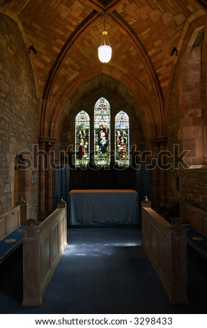 Old protestant church at Brecon, Wales. Benches, arches. - stock photo