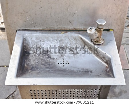Old public faucet in under repairing. - stock photo