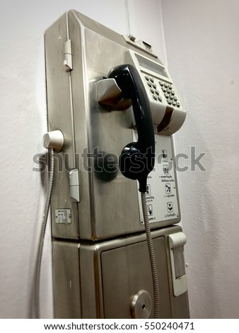 old public telephone coin, Payphone on the wall