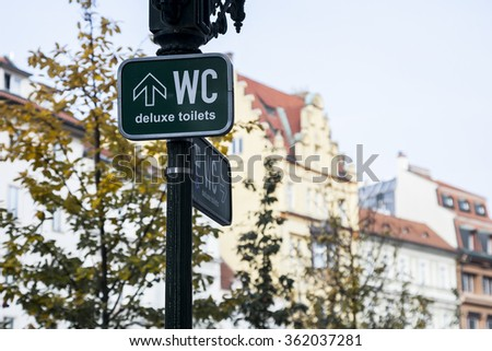 Old public toilets WC sign, sign of toilet, restroom. - stock photo