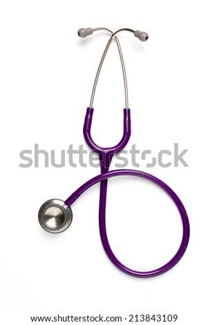 Old purple stethoscope on isolated - stock photo