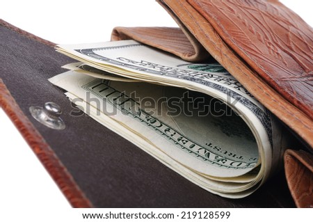 Old purse with banknotes of hundred dollars inside. Closeup with shallow DOF. Isolated on white background.