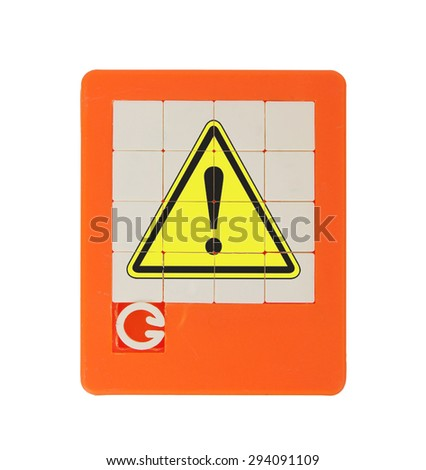 Old puzzle slide game, isolated on white - danger symbol