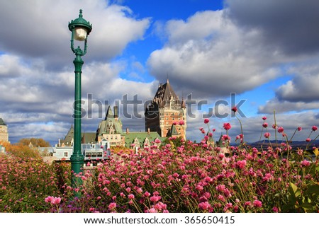 Old Quebec and beautiful flowers in the foreground - stock photo