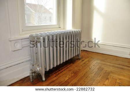 old radiator in an empty historic home - stock photo