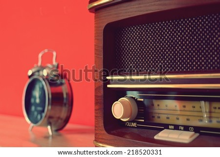 Old radio and alarm clock in retro style - stock photo