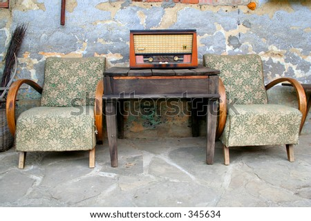 old radio and chair - stock photo