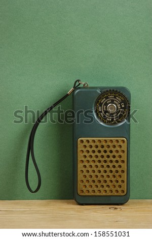 old radio on a wooden shelf - stock photo