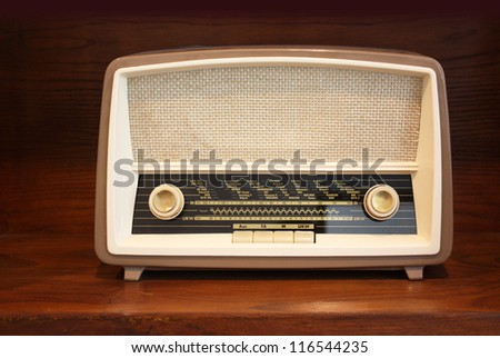 Old radio on wooden shelf