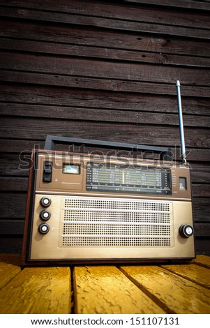 Old radio on yellow table  - stock photo