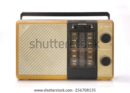 old radio the receiver dirty and dusty inscriptions Cyrillics on a white background white balance  special toning - stock photo