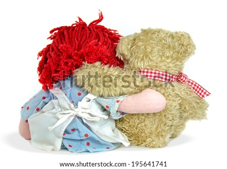 old rag doll with teddy bear isolated on white - stock photo
