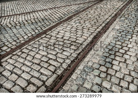 Old rail lines on cobbled road surface at a Liverpool dock. - stock photo