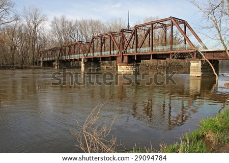 Old railroad bridge over the Grand River, Michigan - stock photo